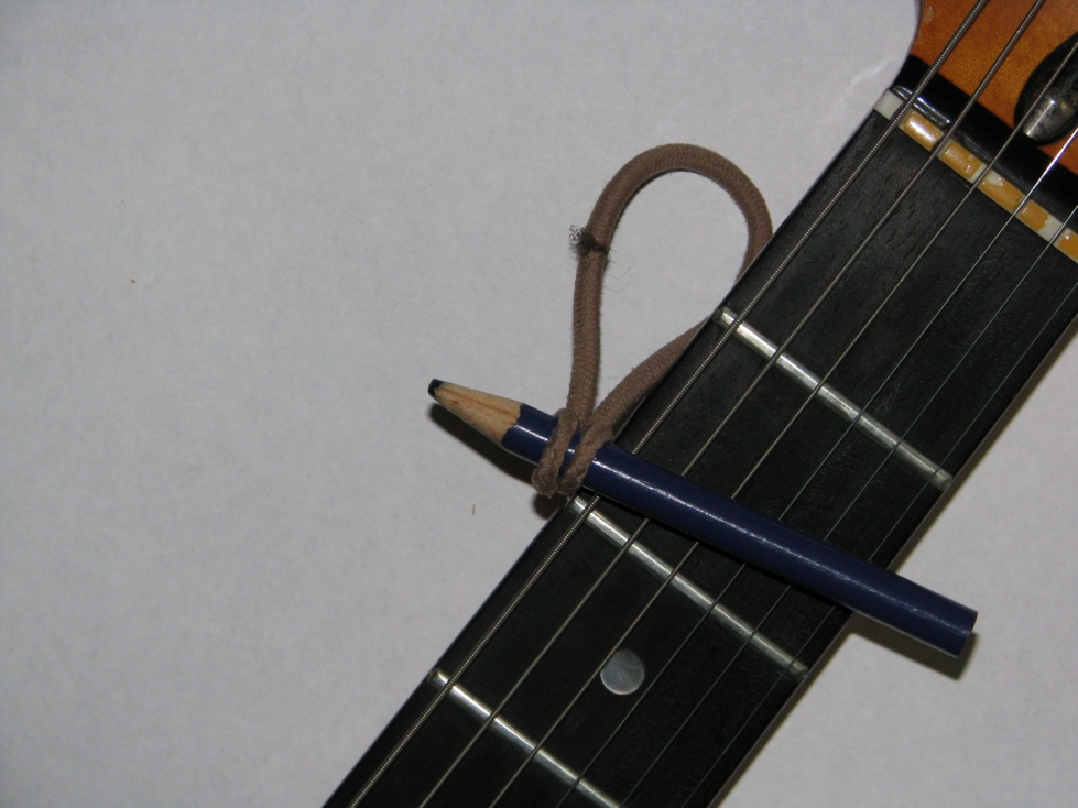 capo on the fly diy makeshift capo mage music guitars. Black Bedroom Furniture Sets. Home Design Ideas